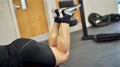 DUMBBELL LYING HAMSTRING CURL